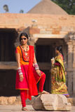 Indian woman standing in the courtyard of Quwwat-Ul-Islam mosque Royalty Free Stock Image