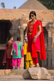 Indian woman standing in the courtyard of Quwwat-Ul-Islam mosque Stock Photo