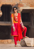 Indian woman standing in the courtyard of Quwwat-Ul-Islam mosque Royalty Free Stock Images