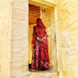 Indian woman standing in her doorway in Jodhpur.