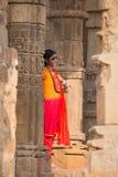 Indian woman standing at Quwwat-Ul-Islam mosque, Qutub Minar, De Stock Image