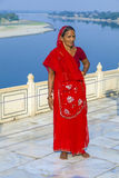 Indian woman stands in front of the river Yamuna Stock Photography