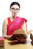 Indian woman studing Stock Photography
