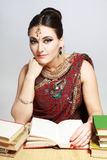 Indian woman studing Royalty Free Stock Images