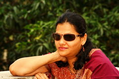 Indian woman in sunglasses Stock Images