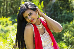 Indian woman in sunlight Royalty Free Stock Image