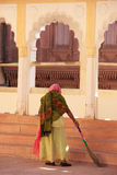 Indian woman sweeping floor, Mehrangarh Fort, Jodhpur, India Stock Photo