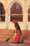 Indian woman sweeping floor, Mehrangarh Fort, Jodhpur, India Royalty Free Stock Images