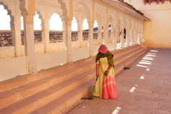 Indian woman sweeping floor, Mehrangarh Fort, Jodhpur, India Royalty Free Stock Photo