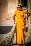 Indian woman sweeping streets Stock Photo