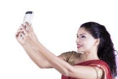 Indian woman taking selfie photo Royalty Free Stock Photo
