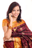 Indian woman taling on mobile phone Stock Images