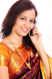 Indian woman taling on mobilephone Stock Photo