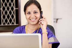 Indian woman talking on a cellphone Stock Image