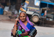 Indian woman talking on mobile phone on the street Stock Image