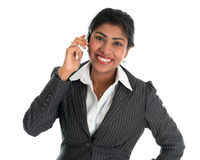 Indian woman talking on phone. Smart Indian business woman on the phone smiling happy isolated on white background. Beautiful Asian female model Stock Photography