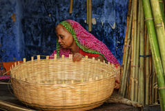 Indian woman in traditional clothes making a basket, Jodhpur, In Royalty Free Stock Images