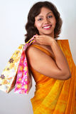 Indian woman in traditional saree with shopping ba Stock Photos