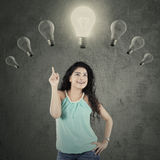 Indian woman under lightbulb Stock Image
