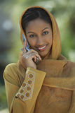 Indian Woman Using Cell Phone Royalty Free Stock Photography