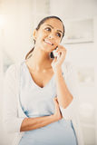 Indian woman using mobile phone happy beautiful Stock Photography