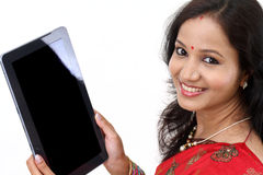 Indian woman using a tablet computer royalty free stock photos