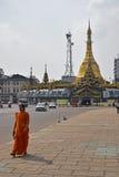An Indian woman walking away from Sule Pagoda in Yangon, Myanmar Royalty Free Stock Image