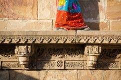 Indian woman walking on beautiful border patterns & designs engr Stock Photos