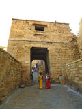 Indian woman walking in fort of Jaisalmer, India stock image