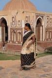 Indian woman walking near Alai gate, Qutub Minar, Delhi, India Stock Photo