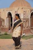 Indian woman walking near Alai gate, Qutub Minar, Delhi, India Stock Photos