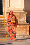Indian woman walking out of the temple, Pushkar, India Stock Photos