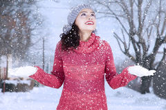 Indian woman with warm clothes playing snow Stock Images