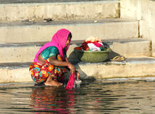 Indian woman washing clothes in the lake Royalty Free Stock Photo