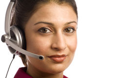 Indian Woman Wearing Headset. Friendly Indian Customer Care Representative Wearing Headset Royalty Free Stock Photos