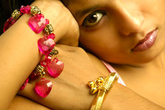Indian woman wearing jewelry stock image