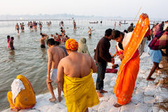 Indian woman wears a sari after bathing. In holy water of Sangam during the biggest festival in the world, Kumbh Mela on in Allahabad, India Royalty Free Stock Images