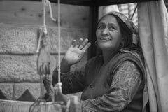 Indian woman weaving cloth Stock Photos