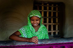 Indian Woman weaving Royalty Free Stock Images
