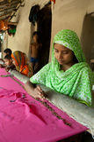 Indian Woman weaving. Young Indian women are brocading Zari in clothes at home as a part of cottage industry in India Stock Photography