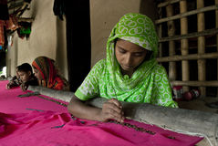 Indian Woman weaving Stock Image