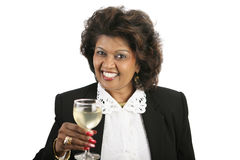 Indian Woman - White Wine. An attractive Indian woman in a business suit drinking a glass of white wine. Isolated on white Royalty Free Stock Image