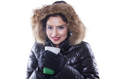 Indian woman with winter clothes holds hot coffee Royalty Free Stock Images