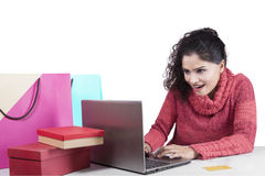 Indian woman with winter clothes shopping online Stock Photos