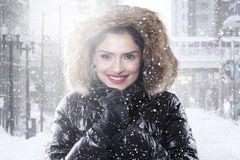 Indian woman with winter coat on the road royalty free stock photos