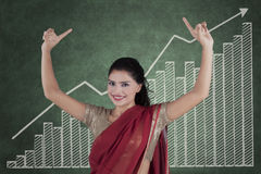 Indian woman worker with growth graph Stock Photography