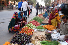 Indian women buying fruit and vegetables by the side of the road in Jaipur Royalty Free Stock Photos