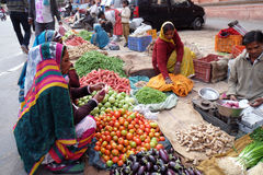 Indian women buying fruit and vegetables by the side of the road in Jaipur Stock Image
