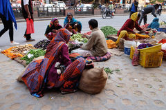 Indian women buying fruit and vegetables by the side of the road in Jaipur Stock Images