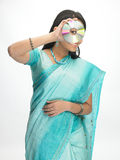 Indian women with the CD Stock Photography